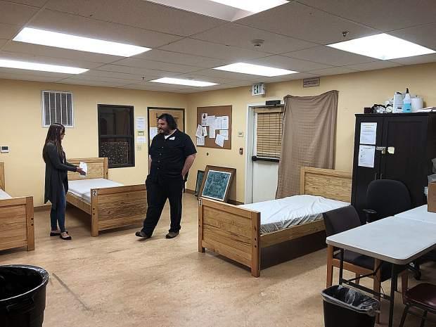 Ashley Quadros, left, and Isaias Acosta converse in Hospitality House's new outreach dorm. The development director and program manager hope to open the space up to pet owners by November.
