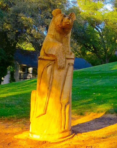 This statue of the bear was carved out of a tree that was taken down at the Golf course at Lake of the Pines by a person unknown to me.