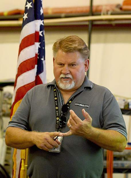 Charles R. Jones, FAA safety team manager of the Flight Standards District Office of Sacramento, discusses the criteria in presenting the Wright Brothers Master Pilot Award to Rick Utermoehlen during a ceremony at the Nevada County Airport.