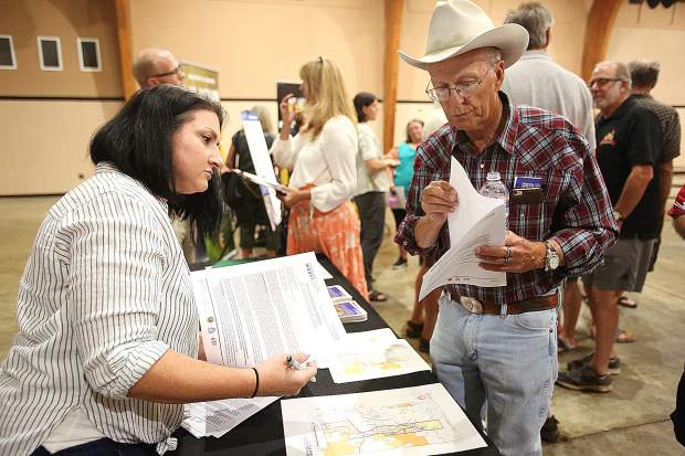 Nevada County Fire Safe Council's Jamie Jones helps Grass Valley's Jon Peek sign up to have his properties' fuels reduced during Wednesday's meeting about the Ponderosa West Grass Valley Defense Zone Project.