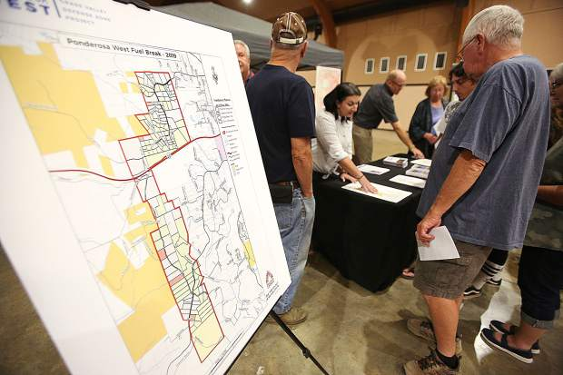 Hundreds gathered at the Nevada County Fairgrounds Wednesday evening to learn about the Ponderosa West Grass Valley fuel break and sign up to have their properties maintained if within the project's boundaries.