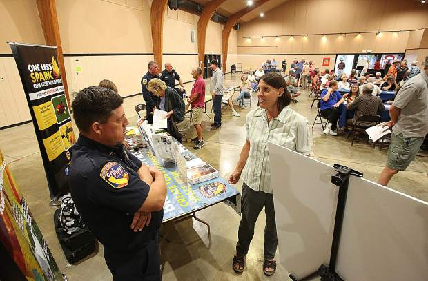 Inquisitive community members get their questions answered during the forum for people in and around the Ponderosa West Grass Valley fuel break project.