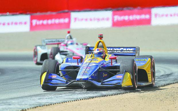 Nevada City's Alexander Rossi holds off Team Penske opponent Will Power coming out of turn 4 at Laguna Seca Sunday during the Firestone Grand Prix of Monterey.