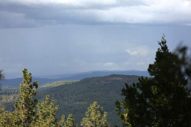 Dramatic skies and thunderstorms loom on the horizon to the east Tuesday afternoon, keeping area fire lookouts busy tracking lighting strikes and smoke checks.