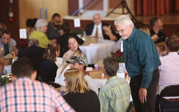 Grass Valley Community Development Director Tom Last talks with members of the community during Thursday's Economic Resource Council summit meeting.