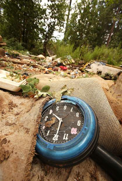A clock, carpeting and other refuse is left behind on a Brunswick Road property where a large homeless encampment existed.