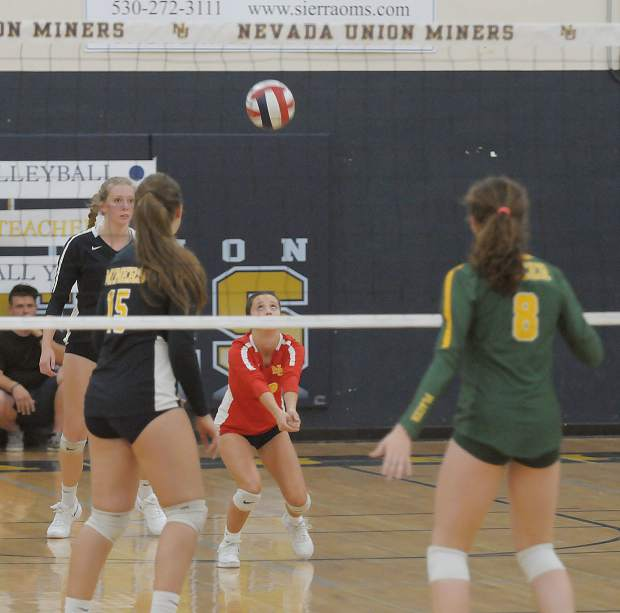 Nevada Union's Kendall Gould digs a ball during the Lady  Miners win over Placer Monday.