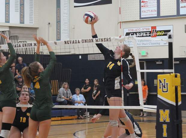 Nevada Union's Emerson Dunbar spikes the ball during a contest with Placer Monday at Albert Ali Gymnasium.