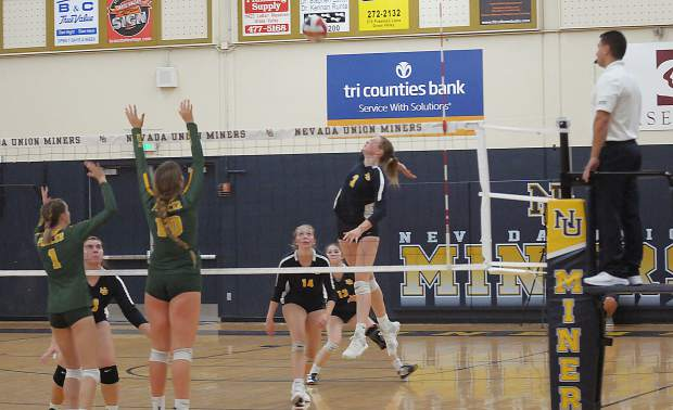 Nevada Union's Faith Menary spikes the ball during a contest with Placer Monday at Albert Ali Gymnasium.