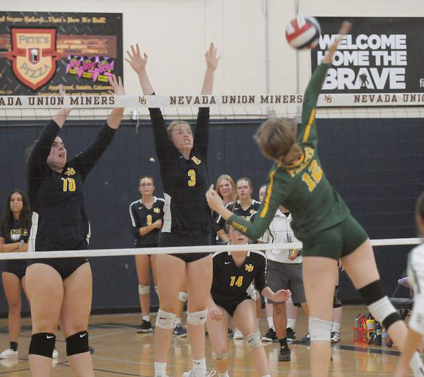 Nevada Union's Faith Menary (3) and Ashlyn Franssen (18) go up for the block during a contest with Placer Monday at Albert Ali Gymnasium.