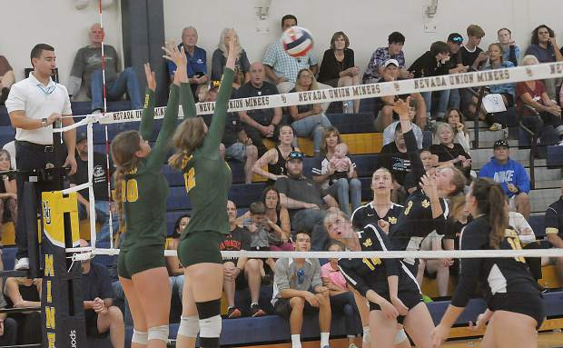 Nevada Union's Faith Menary returns the ball during a contest with Placer Monday at Albert Ali Gymnasium.