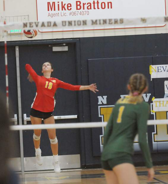 Nevada Union's Kendall Gould serves during a contest with Placer Monday at Albert Ali Gymnasium.