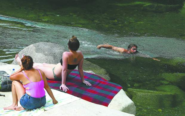 Folks utilized Thursday's warm temperatures to take a dip in the South Yuba River near the Highway 49 bridge Thursday. Temperatures will begin to drop for the next few days.