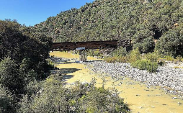 The South Yuba River at Bridgeport shows signs of contamination Saturday.