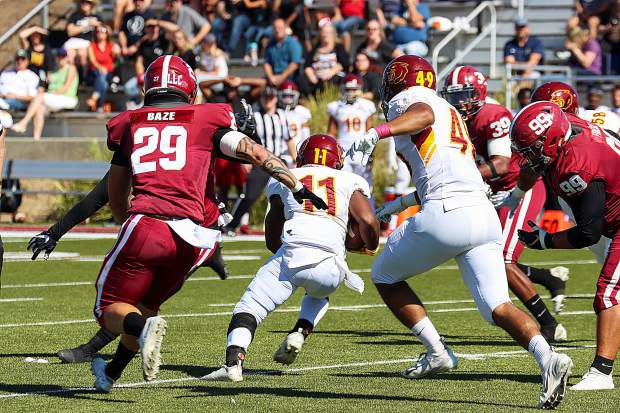 Sierra College linebacker Austin Baze (29) pursues a Sacramento City College ball carrier during Saturday's game. Baze, a 2018 Bear River g raduate, tallied eight tackles, including a sack in the game. Sierra won, 45-20.