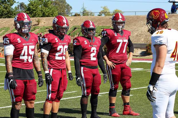 Sierra College linebacker and team captain Austin Baze (29), along with three other Sierra captains, meet with the Sacramento City College captains ahead of Saturday's game. Baze, a 2018 Bear River g raduate, tallied eight tackles, including a sack in the game. Sierra won, 45-20.