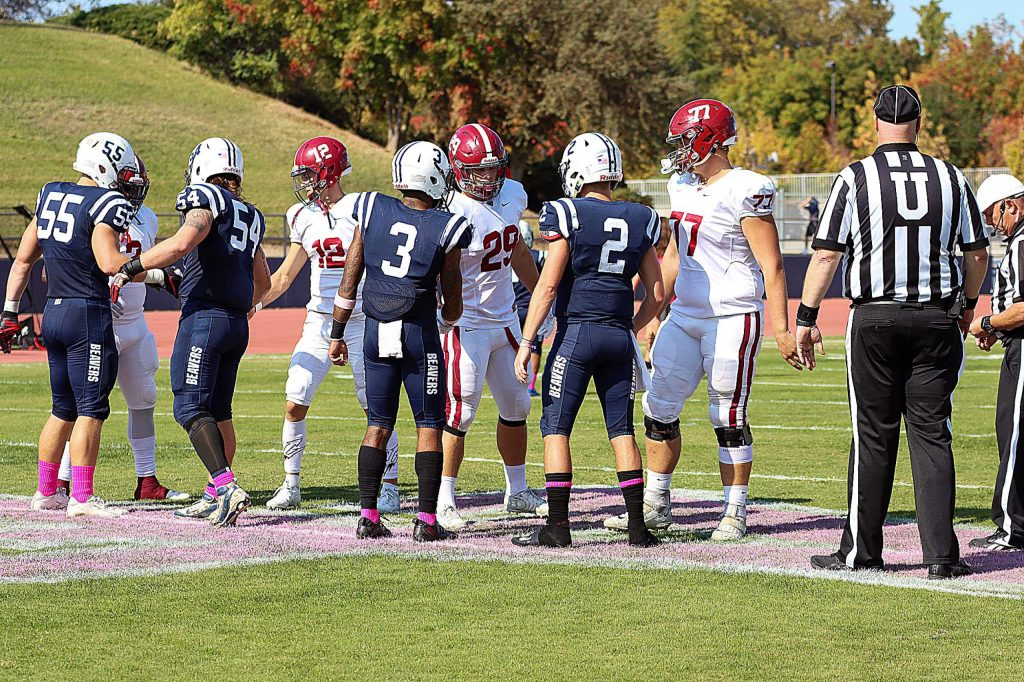 American River's Justin Houlihan (54) and Sierra's Austin Baze (29) were among the captains for Saturday's bout between the two Sacramento area community colleges. Hulihan is a 2018 Nevada Union grad. Baze is a 2018 Bear River grad.