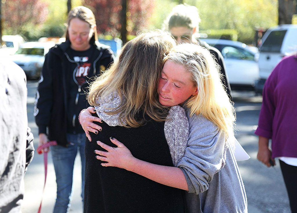 Friends, family and community members consoled one another as they gathered to initiate a search for Crystal Ashworth, who was last seen leaving Uncle Sonny's at the Cedar Ridge Y Sunday night.