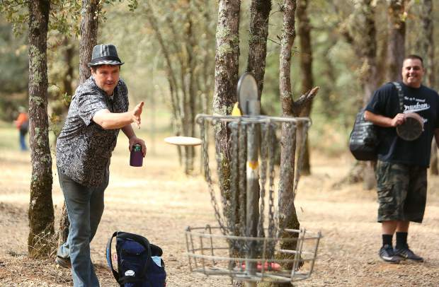Grass Valley's Coryon Redd makes a putt during the disc golf tournament hosted by the Nevada County Disc Golf Association. Held in honor of Derek Sorensen, the golf tournament is in its fifth year of partnering with the United Way of Nevada County.