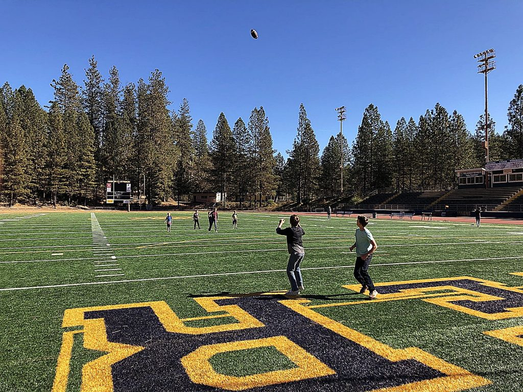 Children of teachers and administrators took to the Nevada Union High School football field to toss around a football.
