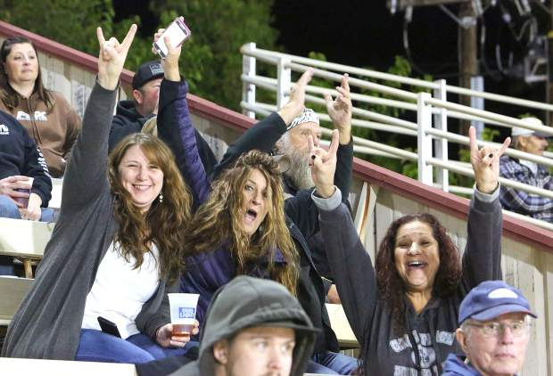 Some of the many happy folks watching Vintage Duels racing at the Nevada County Fairgrounds Friday evening.