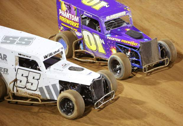 Josh Wiesz (55) and Jeremy Blackshere (01) vie for position as they enter a turn Friday night at the Nevada County Fairgrounds where Vintage Duels racing returned after a 25 year hiatus.