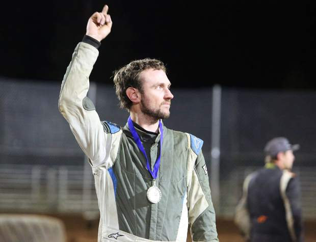 Ryan Winter signals he's number 1 to the crowd after having the gold medal placed around his neck for beating out the competition in Friday night's Vintage Duels racing.