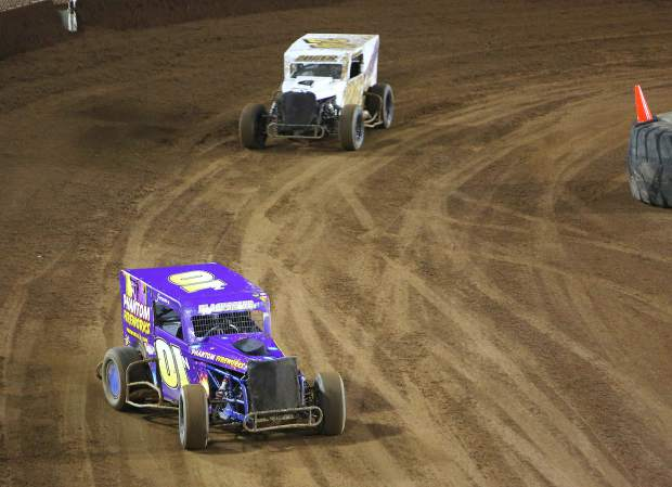 Jeremy Blackshere (01) pulls away from Josh Wiesz (55) Friday night at the Nevada County Fairgrounds where Vintage Duels racing returned after a 25 year hiatus.