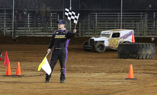 The checkered flag is waved after a ten lap double elimination race commences.