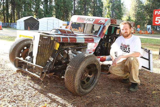 Patrick Weger, promoter of the Vintage Duels races coming to the Nevada County Fairgrounds, poses with his dwarf class race car. The fairgrounds arena is set to host to a dirt track racing event featuring dwarf car head-to-head races on Friday.