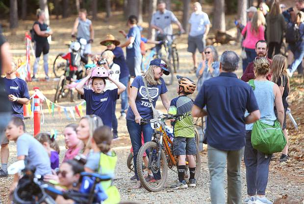Hundreds of spectators filled the Sanchez family's property off Osborne Hill Road to support the youngsters in the first Union Hill Invitational Mountain Bike Race.