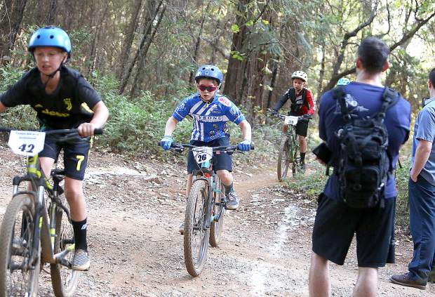The youngsters get a taste of competitive mountain bike racing during Tuesday's invitational on Osborne Hill Road Tuesday.