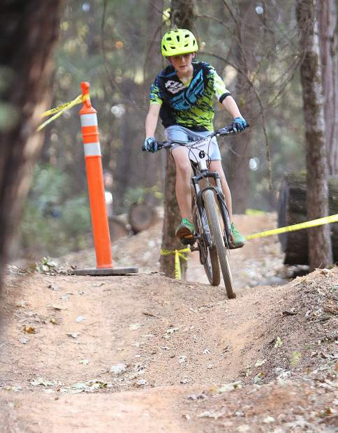 A young mountain bike racer takes to the twists and turns of the three lap course which took place alongside those of TDS Enduro courses designed for the invitational race which brings pro riders to Osborne Hill each year.