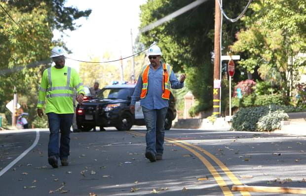 PG&E employees arrive on scene to assess the damage and begin the process of replacing the broken utility pole.