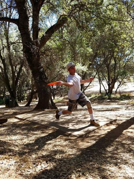 Jason Burns tees off at a previous Derek Sorensen Doubles Memorial Disc Golf Fundraiser Tournament.