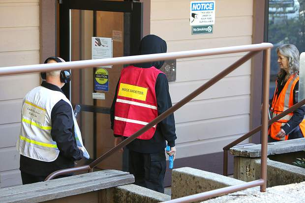 A mock shooter walks into the Brighton Greens Resource Center in Grass Valley where different law enforcement agencies held an active shooter drill Friday morning.