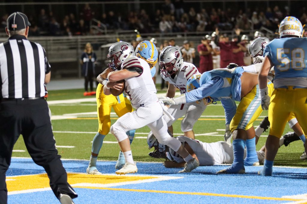 Bear River's Ryder Kiggins charges into the end zone during a game against Center Friday night.