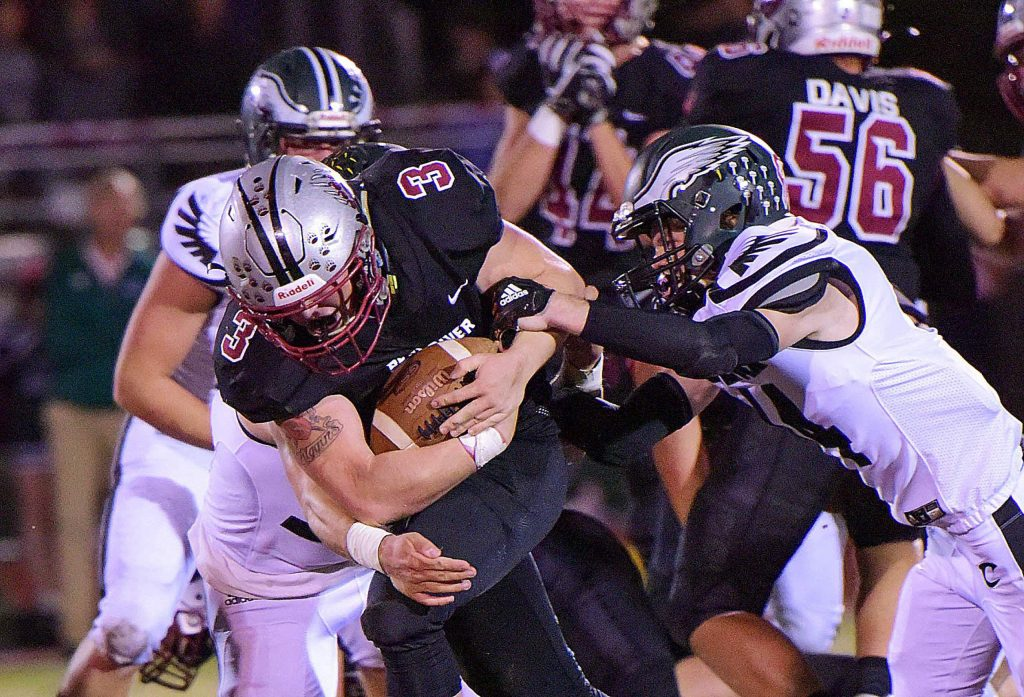 Bear River's Ryder Kiggins fights for extra yards during a game against Colfax Friday night at J. David Ramsey Stadium.