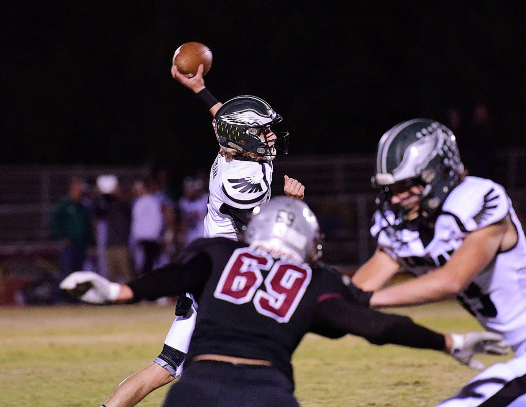 Colfax quarterback Travyn Heimann gets a pass off during a game against Bear River Friday night.
