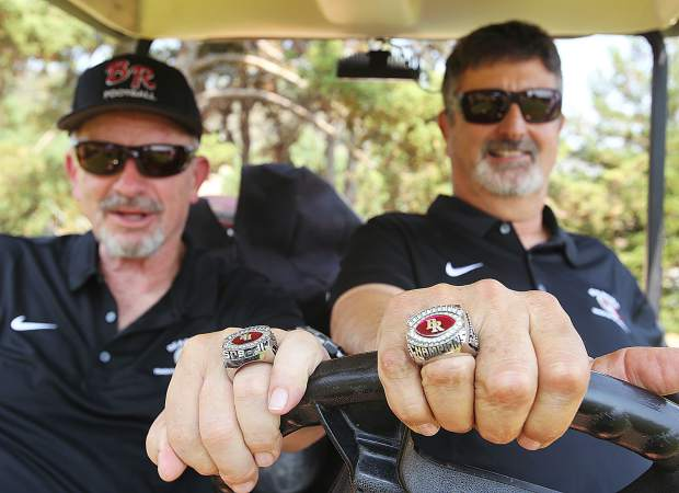 In this 2018 file photo, Bear River co-head coaches Terry Logue, left, and Scott Savoie show off their 2017 Sac-Joaquin Section Championship rings.