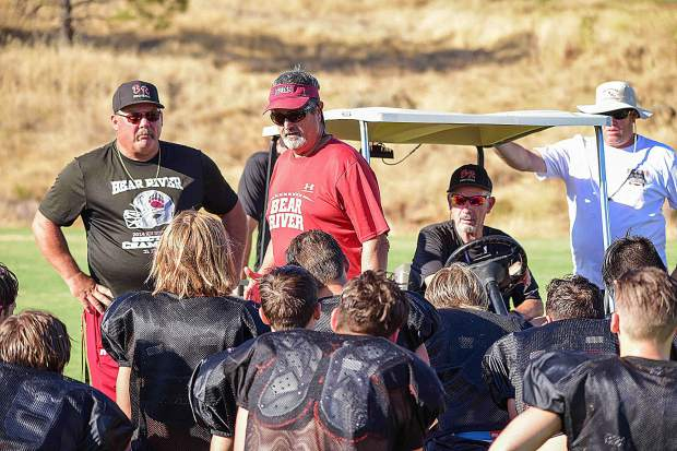 Longtime Bear River co-head coaches Scott Savoie (red shirt) and Terry Logue (sitting in golf cart) have led the Bruins to four Sac-Joaquin Section Division V title games in the last five years, winning the crown in 2014 and 2017.