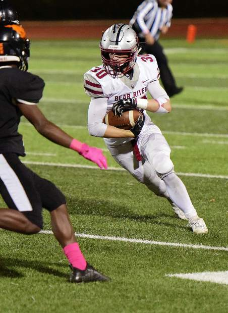 Bear River's Zach Fink looks for room to run during a game against Foothill Friday night in Sacramento.