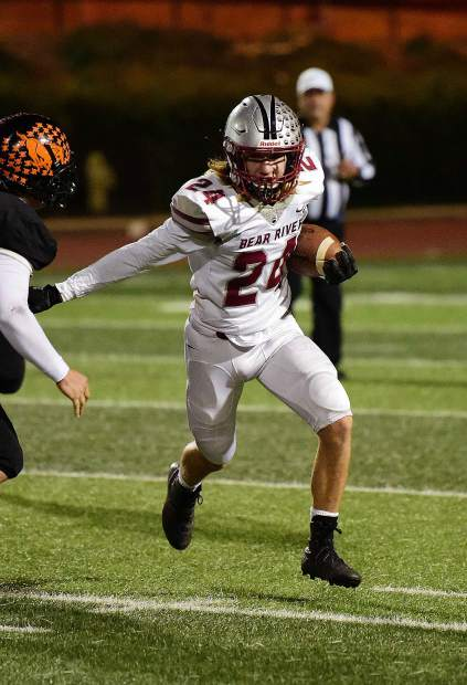 Bear River's Jacob Ayestaran runs the ball during a game against Foothill Friday night in Sacramento.