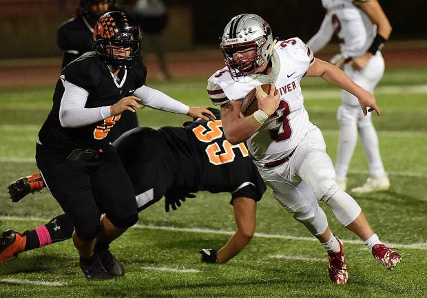 Bear River's Ryder Kiggins looks for room to run during a game against Foothill Friday night in Sacramento.