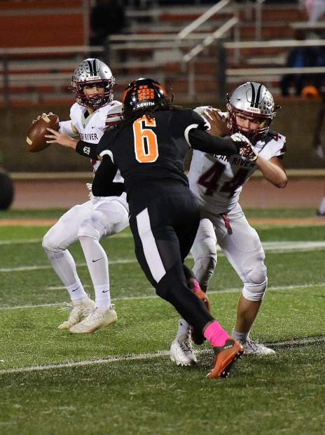 Bear River's Colton Jenkins drops back to pass during a game against Foothill Friday night in Sacramento.