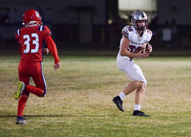 Bear River's Cade Torgerson huals in a pass during a game against Lindhurst Friday night. Bear River won the game 42-14.