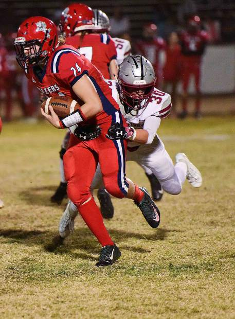 Bear River's Zach Fink pulls down a Lindhurst ball carrier during a league game Friday night. Bear River won the game 42-14.