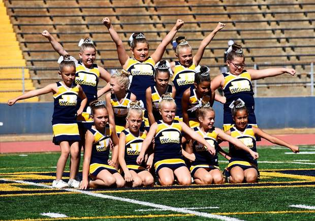 Nevada Union Jr. Miners cheerleaders perform at halftime.