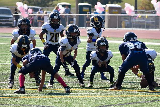 The Nevada Union Jr. Miners 8U football team defeated the Casa Roble Jr. Rams on Saturday, 12-6, in double overtime thanks to stout line play on both sides of the ball.