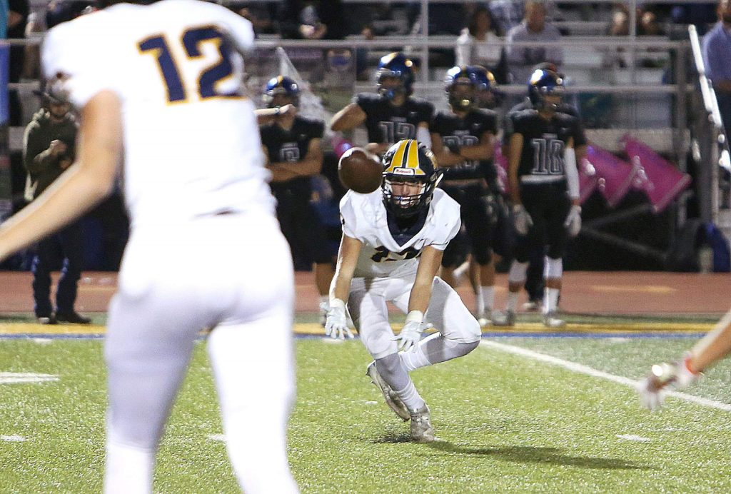 Nevada Union quarterback J.T. Conway attempts a pass to Ben Taylor (17).